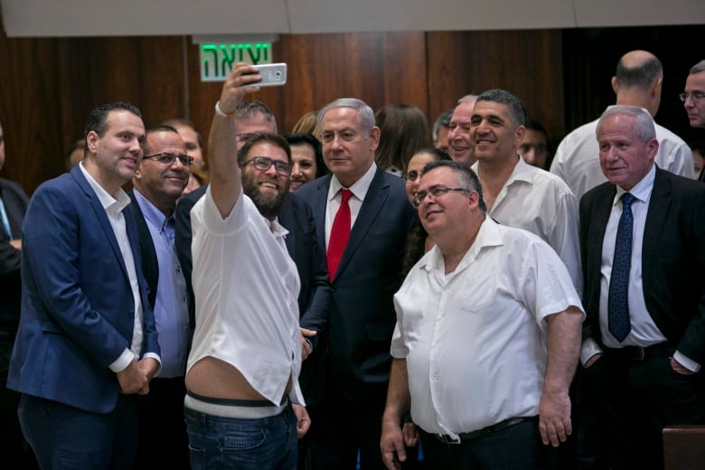 Israel passes Jewish nation-state bill after contentious session in Knesset