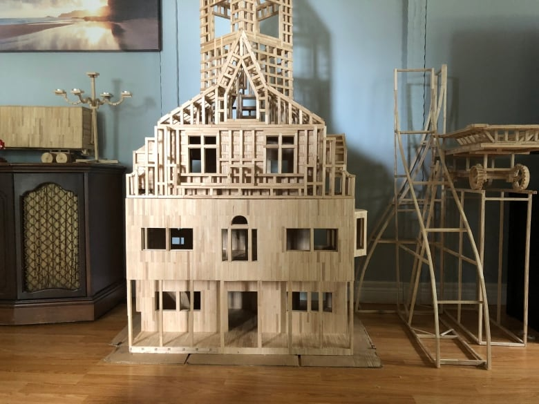 Artist builds everything from a cat castle to engines out of