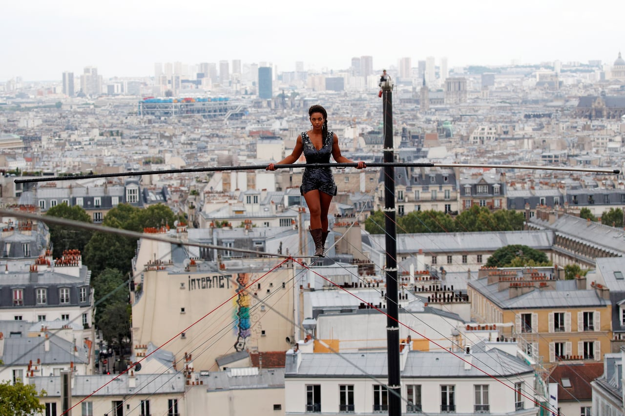 1cff17eb35 Tightrope walker stuns Parisians with high-wire feat