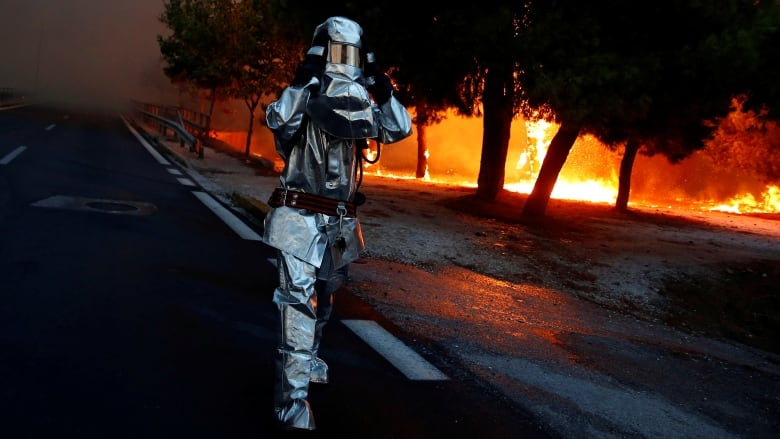 Death toll jumps to 49 as strong winds fuel Greece wildfires