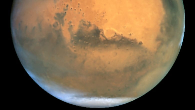 Researchers spot what looks like a standing 'lake' of water on Mars