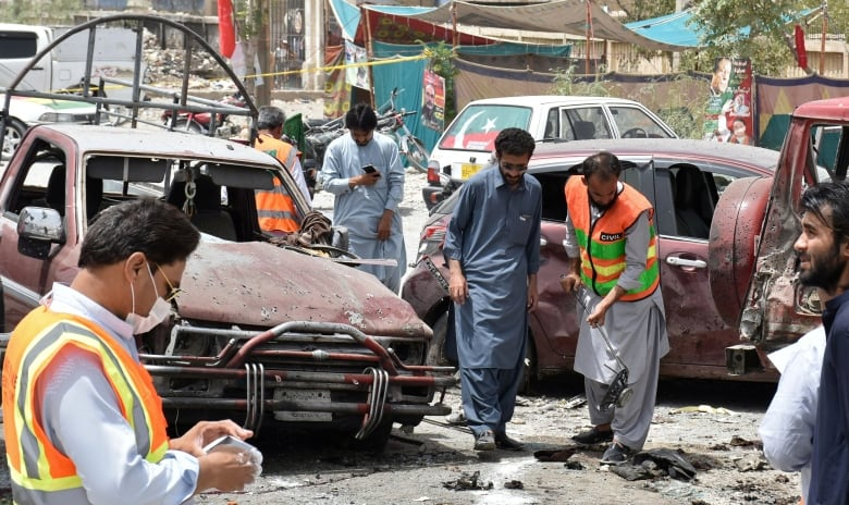 Members of a bomb-disposal unit survey the site of the suicide blast in Quetta on Wednesday