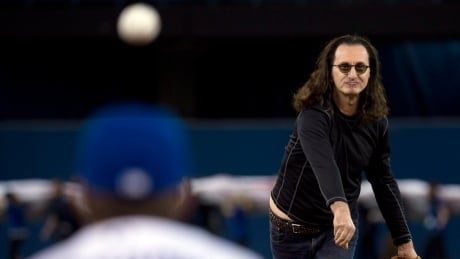 Geddy Lee throws out the first pitch in 2013