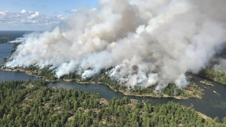 Northern Ontario forest fire creeps toward highway thumbnail