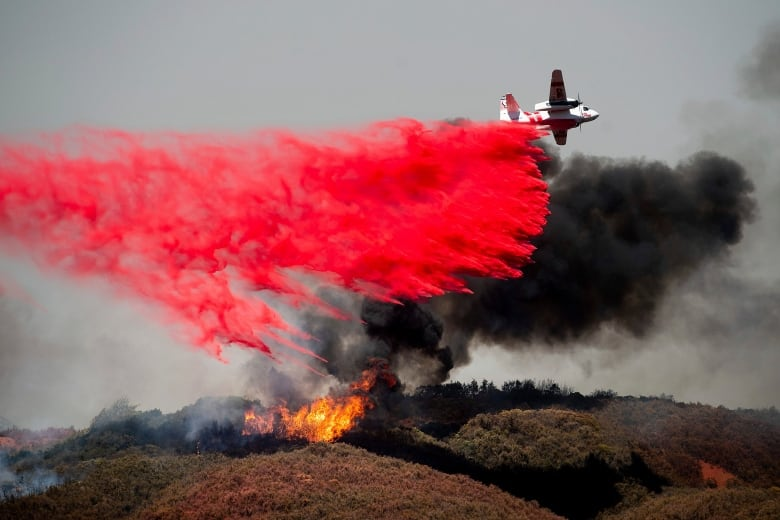 California crews scramble to keep flames from reaching homes