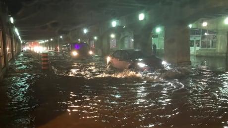 Heavy rains flood downtown Toronto