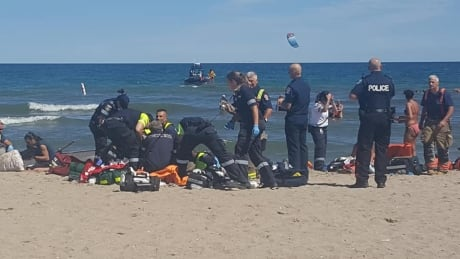 TDSB identifies teen who died after trying to save mother and son at Woodbine Beach | CBC