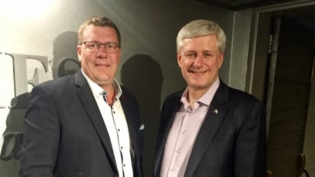 No conflict after Premier, MLAs spotted at Rider game with Harper and Wall: Commissioner thumbnail