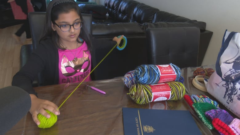 aaf3c1db3a2 Siblings launch loom-knitting initiative to provide hats for newborn babies