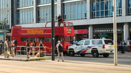 7 people taken to hospital after police SUV, tour bus collide at Queen's Quay | CBC