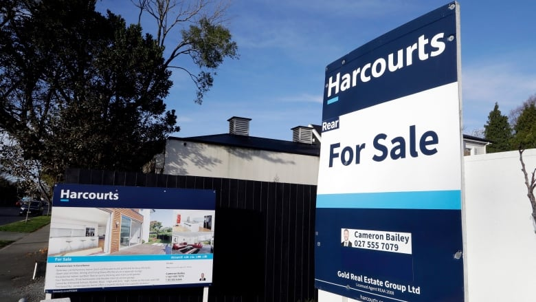 New Zealand bans most foreigners from buying homes amid rise in