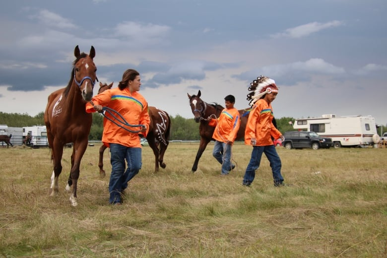 Head S Team Members Exercise Their Horses Before Race Time