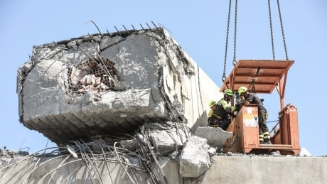 Rescuers clearing rubble from Italian bridge after collapse that killed at least 38
