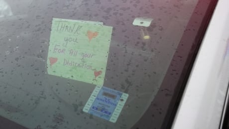 Thank you note in police cruiser