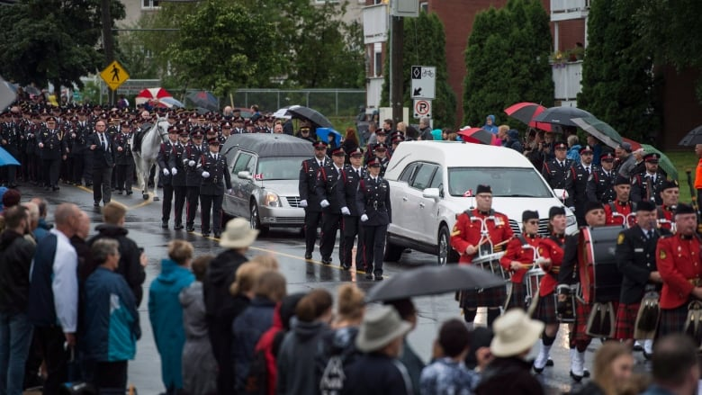 Hundreds line Fredericton streets to say goodbye to fallen officers | CBC News
