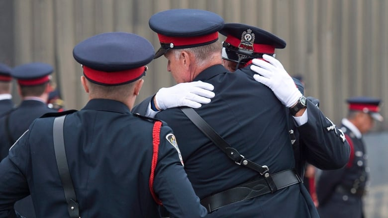 f3f4e77e8a98b Fredericton police officers gather outside the Aitken University Centre  after the regimental funeral Saturday for Const. Sara Burns and Const.