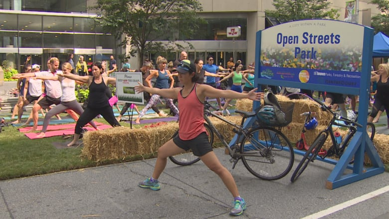 Cars begone! Walkers, cyclists take over roads downtown during Open Streets TO
