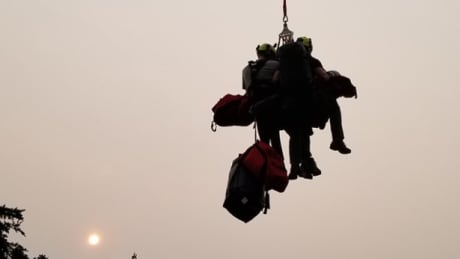 North Shore Rescue warns of long response times as helicopters used in fire fight