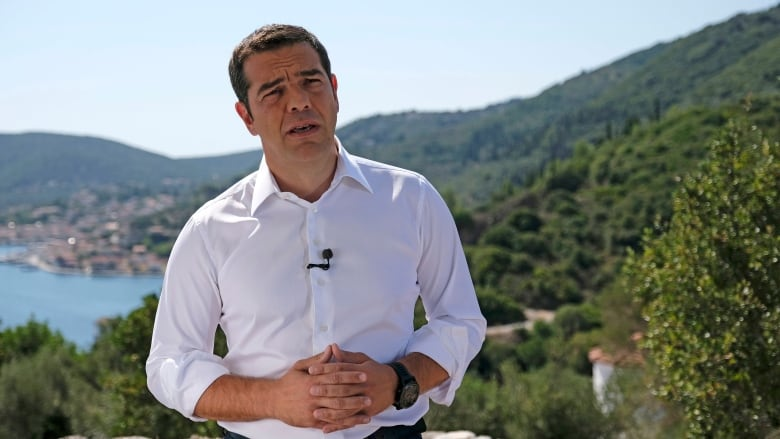 Greek Prime Minister heads to Odysseus' home at end of bailout journey
