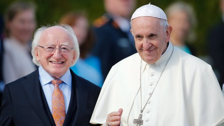 a260dac133f Pope Francis, right, is flanked by Irish President Michael D. Higgins, upon  his arrival at the presidential residence in Dublin on Saturday.