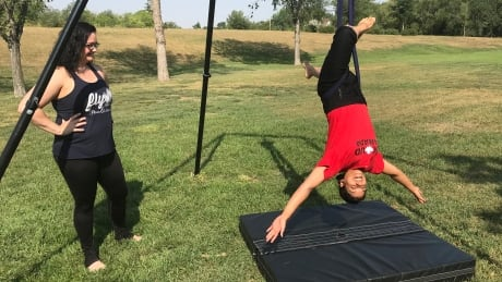 Hanging with FLY ladies: Aerial arts offer a chance to conquer fears and 'be a kid again' thumbnail