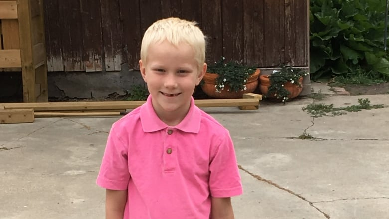 Divers search for missing 7-year-old boy after mother found
