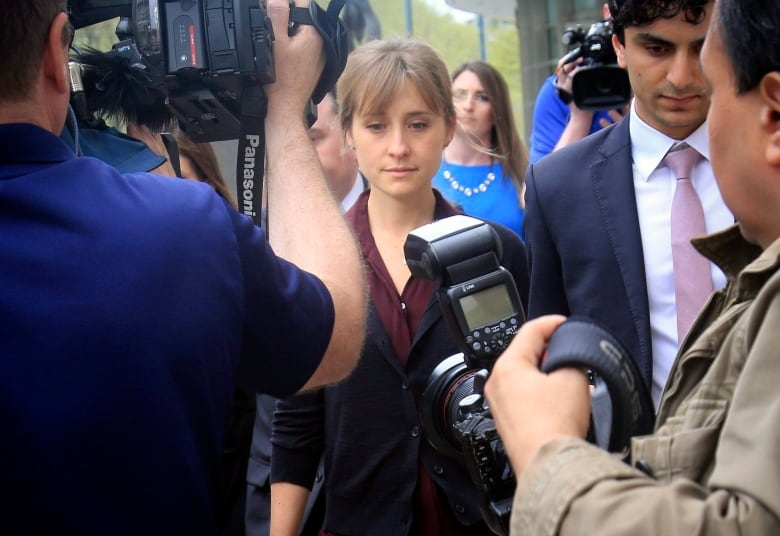 Trial opens in sex-trafficking case against self-help guru