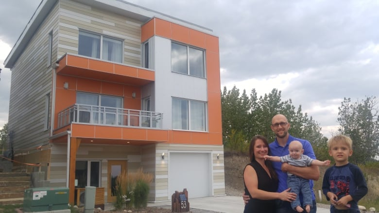 Calgary home certified as albertas 1st passive house cbc news ania kania richmond stands with her husband kit richmond and children aren and theo in front of their certified passive house in the neighbourhood of solutioingenieria Choice Image