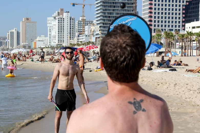 Tic tac tic matkot is the sound of summer on israels beaches cbc derek stoffelcbc publicscrutiny Image collections