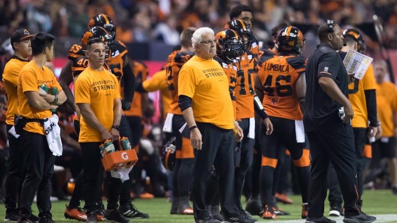 40787e469 B.C. Lions head coach Wally Buono, centre, watches from the sideline in his  Diversity Is Strength shirt. The CFL's new initiative looks to promote the  ...