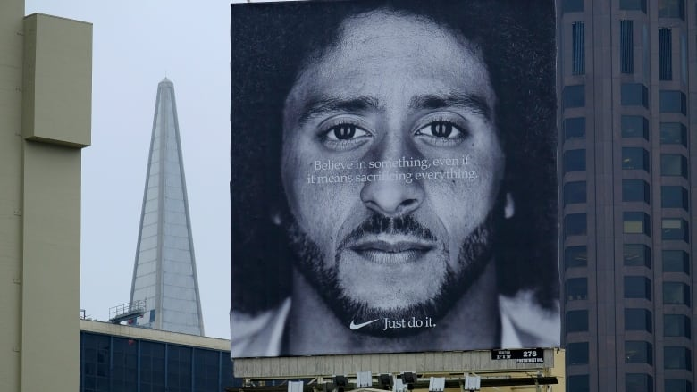 first rate d7293 1fb38 A large billboard stands on top of a Nike store in San Francisco showing  former 49ers quarterback Colin Kaepernick. (Eric Risberg Associated Press)