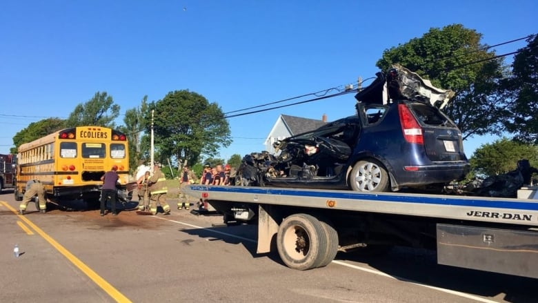 22-year-old woman dies after crashing into a school bus on