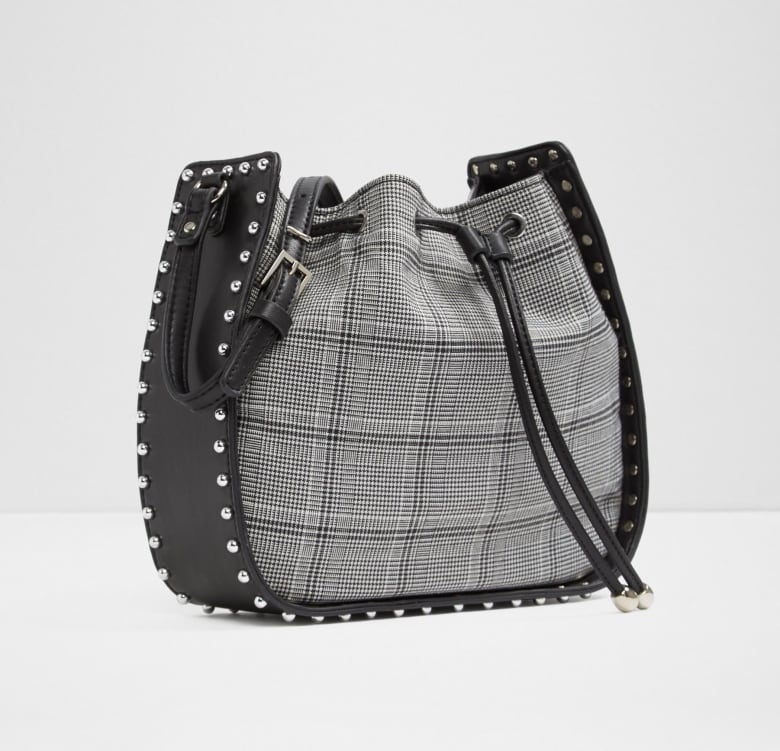 78ee432c5a80 Menswear fabrics are ubiquitous this fall, particularly when styled in  unexpected or head-to-toe combinations. Why not try this plaid bag with  synthetic ...