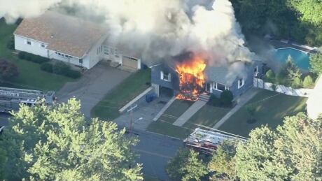 About 20 Boston-area houses on fire after suspected gas explosions