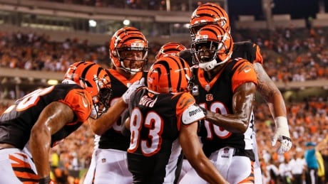 Andy Dalton throws 4 TD passes as Bengals hang on to beat Ravens