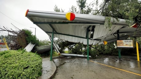 HURRICANE FLORENCE fallen tree lies atop the crushed roof