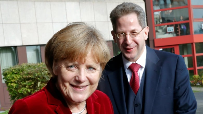Merkel averts coalition split by giving German spy boss new role