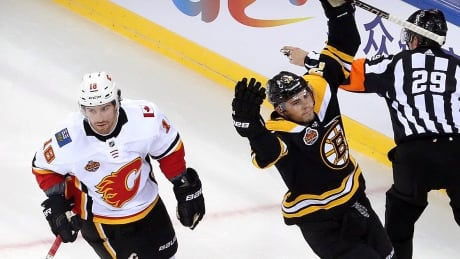 DeBrusk douses Flames, leading Bruins to China Games sweep