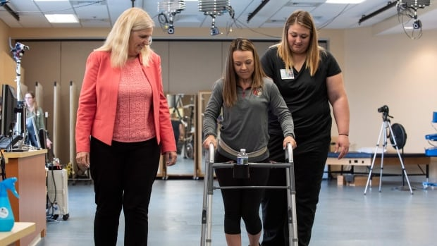 Electrical implants, intense rehab help 3 paralyzed patients take steps again