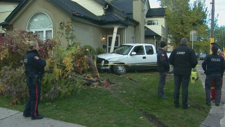Calgary police shoot at stolen truck in pursuit that ends with truck hitting house