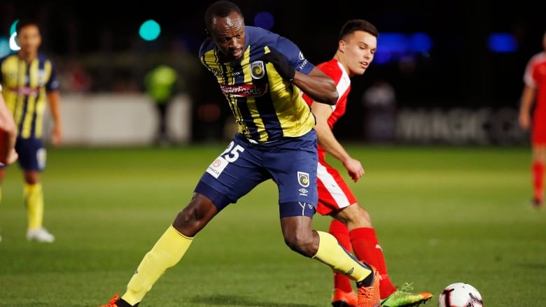 26d6c885721 Usain Bolt overruns the ball during a pre-season match between the Central  Coast Mariners and the Central Coast Select on Friday