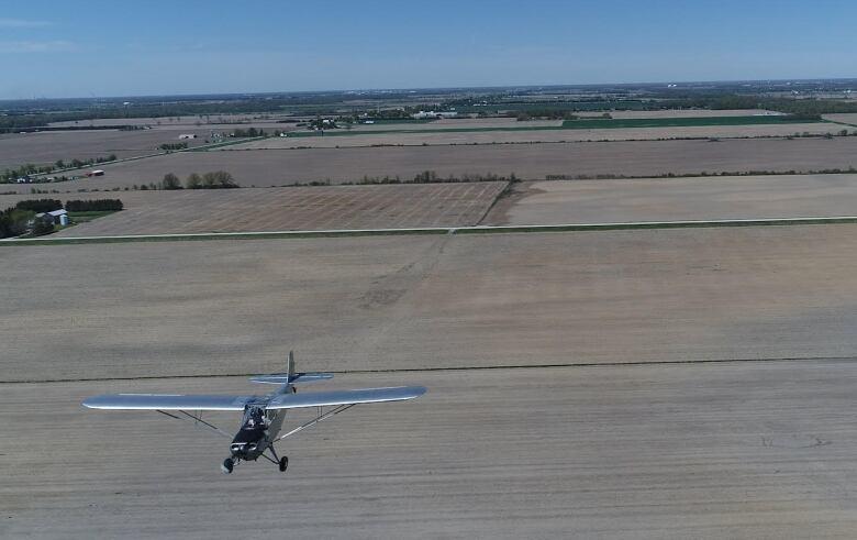 [Image: plane-flying-underneath-drone.jpg]
