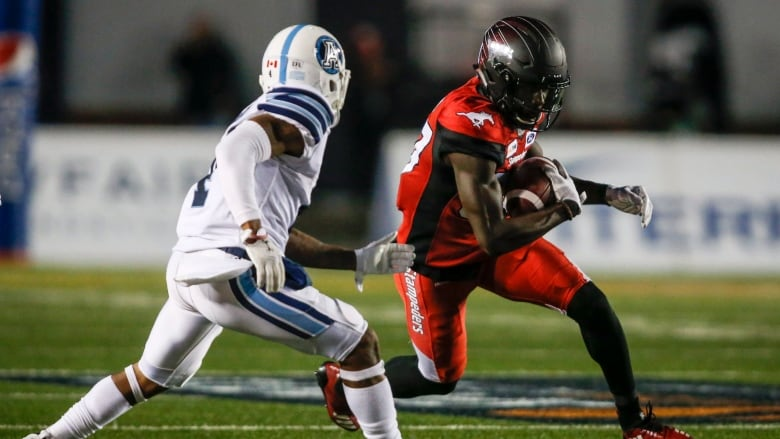 00bcf28a917 Stampeders top Argos to clinch playoff spot