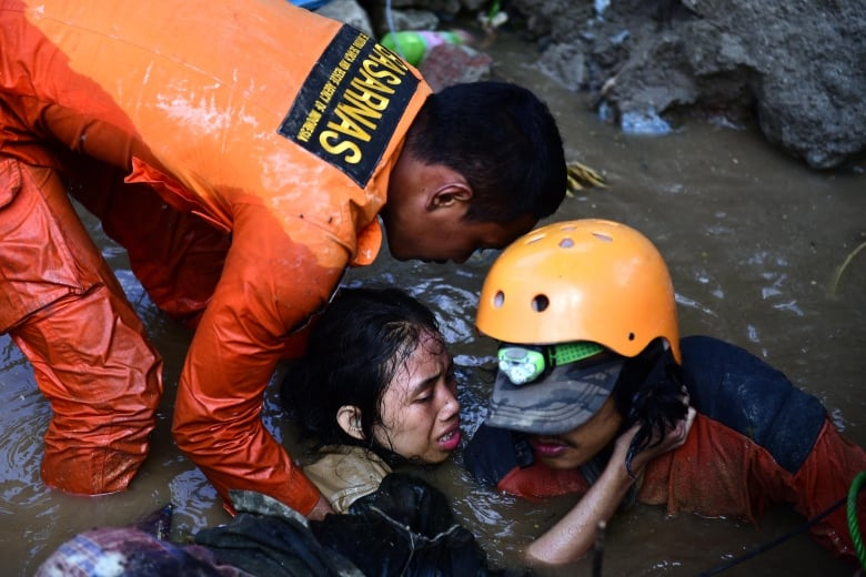 Rescuers rush to save victims trapped by deadly Indonesia quake