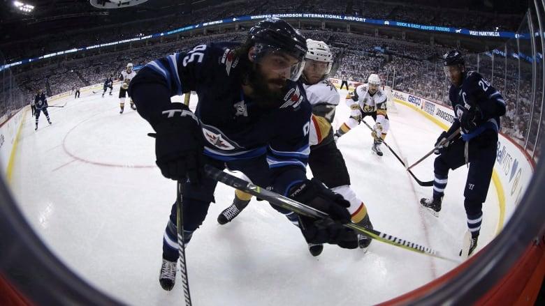 uk availability 412ca f5281 Winnipeg Jets open season with road win as hockey world ...