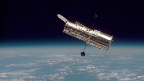 The Hubble Space Telescope in orbit above Earth. Credits: NASA