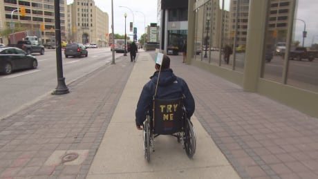 Ismaila Alfa in wheelchair at Portage and Main