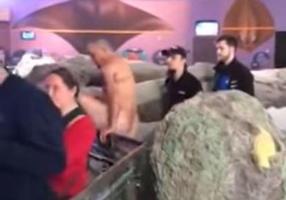 Aquarium skinny-dipper wanted for earlier, violent assault