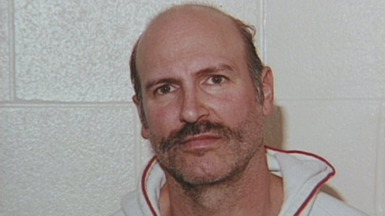 The man behind a huge small-town bank heist wants out of prison