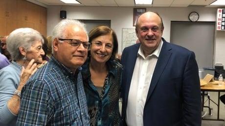 Eliana Di Biase, centre, with cabinet minister Michael Tibollo, right